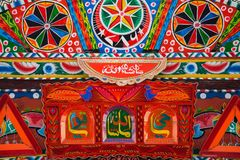 Front side  of a decorated pakistani truck. Decoration pakistani truck art artist paint painter flower heart culture wheels auto bedford punjab jingle concept royalty free stock photography