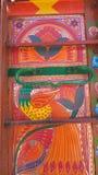 Decoration on a Pakistani truck. Bird decorated truck pakistani decoration front side backside art artist paint painter flower heart culture wheels auto bedford stock photo