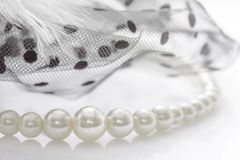 Decoration pearl and lace on white . Stock Image