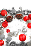 Decoration with pine or fir and red ornaments balls with two gla Royalty Free Stock Photography