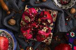 Decoration with pomegranate, traditional pattern tiles, nuts, si Stock Photos