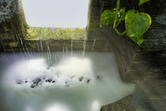 A decoration pond waterfall fountain. Stock Image