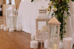 Decoration of a reception: white cloths and white lamps royalty free stock photography
