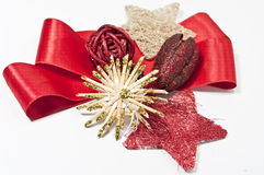 Decoration with a red bow. Christmas decoration with a red bow on white Royalty Free Stock Images
