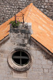 Decoration of the roof of the house with round window Stock Photography