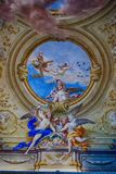 Decoration in the Room of Ladies Court at Royal Palace in Casert. Ceiling decoration in the Hall of Ladies Court at Royal Palace in Caserta, Italy Royalty Free Stock Photography