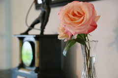 Decoration of rose flowers in the room. Room clock and rose flower decoration Stock Photography