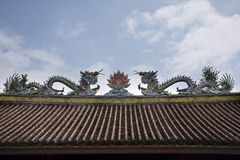 Decoration and sculpture and carving colorful art roof of chinese shrine at Kaiyuan Temple at Teochew city in Guangdong, China. Decoration design and sculpture royalty free stock photos