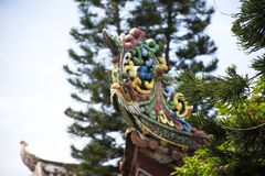Decoration sculpture and carving colorful art roof of chinese shrine at Kaiyuan Temple at Teochew city in Guangdong, China. Decoration design and sculpture and royalty free stock image