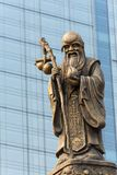 Decoration sculpture on a temple roof. Decoration sculpture on Daci buddhist temple roof against modern building in Chengdu, China stock photos