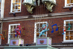 Decoration of sculptures of beasts playing musical notes. Outdoor decoration of beasts playing musical notes Stock Image