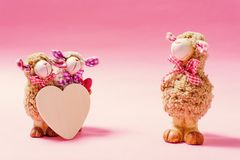 Decoration sheep doll and heart on pink background. Valentine concept stock photo