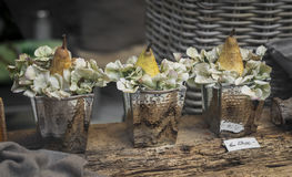 Decoration of shop windows - pears and hydrangea blooms in a vintage metal buckets. Soft focus Stock Photography