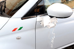 Decoration on the side of a white Italian car Stock Photo