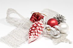 Decoration with a silver bow. Decoration in red and silver on white Royalty Free Stock Photos