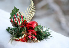Decoration in Snow. Holiday docoration sitting in fresh snow Stock Image