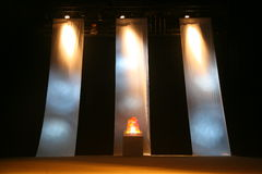 The decoration of the stage, with three vertical fabric strips and imitation of the eternal flame of the heroes memorial monument. Royalty Free Stock Photos
