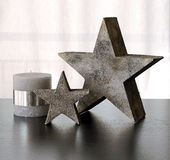 Decoration stars and candle on a table Royalty Free Stock Image