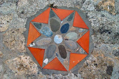 Decoration on the stone floor. Decorative detail on the stone path in the garden Royalty Free Stock Images