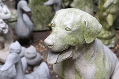 Decoration stone sculpture in the dog shape Royalty Free Stock Photo
