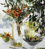 Decoration of the table. Table decorated with flowers and show restraint Royalty Free Stock Image