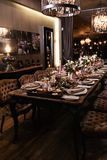 Decoration of a table at a wedding reception or birthday party - Beautiful dark colors royalty free stock photos
