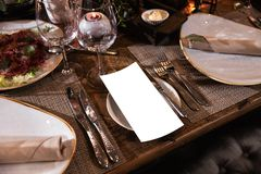 Decoration of a table at a wedding reception or birthday party - Beautiful dark colors royalty free stock images