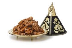 Decoration tajine with fresh baked chebakia Stock Photos