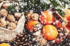 Decoration with tangerines, xmas tree, cones, nuts and snowflakes Royalty Free Stock Photos