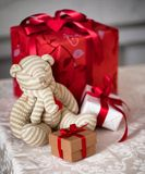 Decoration teddy bear and a gift box. Royalty Free Stock Photos