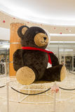Decoration Teddy Bear in shopping mall. Christmas eve. Royalty Free Stock Images
