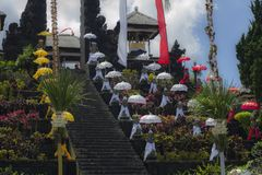 Decoration of a temple in Bali, Indonesia. A Temple in Bali decorated for the Kuningan fest. Colorful decoration of the stairs on a sunny day Stock Photography