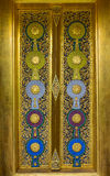 Decoration of Thai temple door with carving and painting Stock Image