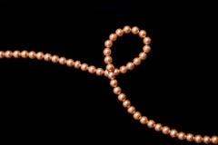 Decoration thread of orange pearls Stock Images