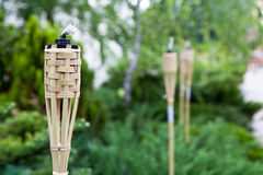 Decoration tiki oil torches. Royalty Free Stock Photography