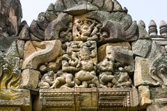 Decoration of stone carvings on top of entrance of an ancient Temple in Thailand. Decoration on top of entrance of an ancient Temple in Thailand carved from Royalty Free Stock Photos