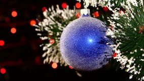 Decoration - a toy shiny blue ball on christmas stock footage