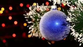 Decoration a toy shiny blue ball hanging on stock footage
