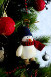 Decoration toy snowman on the Christmas tree. A warm atmosphere of  holiday Stock Photos