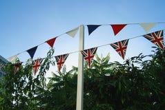 Decoration of triangular Union Jack bunting. Garden decoration of triangular Union Jack bunting Stock Images