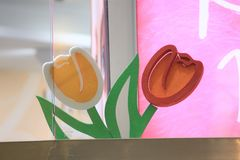 Decoration two tulips. Green orange flowes tulips march 8 spring plastic foam pattern  shop-window red Royalty Free Stock Images