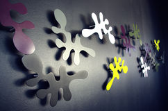 Decoration on the wall. Colorful artistic sculpts as spots and spathes on the wall Royalty Free Stock Photos