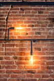 Decoration walls with lamps, pipes and bricks. Old and vintage looking wall, interior design Royalty Free Stock Images