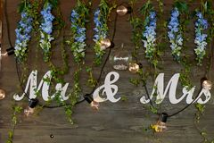 The decoration of the wedding area bride and groom.The inscription mr mrs over the table. The decoration of the wedding area bride and groom. The inscription mr stock image