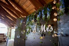 The decoration of the wedding area bride and groom.The inscription mr mrs over the table. The decoration of the wedding area bride and groom. The inscription mr royalty free stock photography