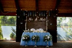 The decoration of the wedding area bride and groom.The inscription mr mrs over the table. The decoration of the wedding area bride and groom. The inscription mr royalty free stock photos