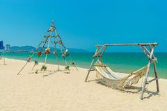 Decoration for wedding on beach with hammock and wooden construction stock photo