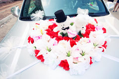 Decoration of the wedding car bears. Red and white decoration of the wedding car bears Stock Photos