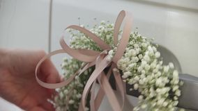 Decoration wedding car with wedding flowers and satin ribbons. stock footage