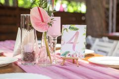 Decoration for a wedding ceremony on a back yard with tables, pl